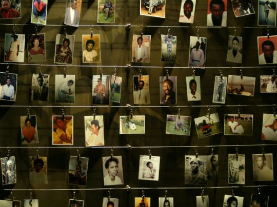 Pictures of killed people donated by survivors are installed on a wall inside the Gisozi memorial in Kigali, Rwanda, which depicts the country's 1994 genocide, April 5, 2004 (Radu Sigheti/Courtesy Reuters).