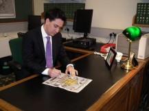 Ed Miliband reading newspaper