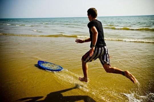 man running through surf