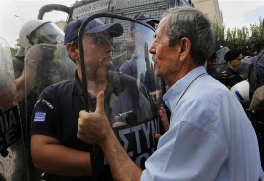 09102012-athens-greece-old-man-talks-to-riot-police