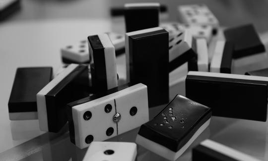 economics-dominos