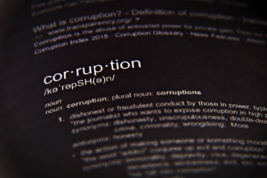The word corruption, close up, selective focus