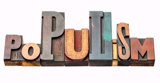 populism word abstract in wood type
