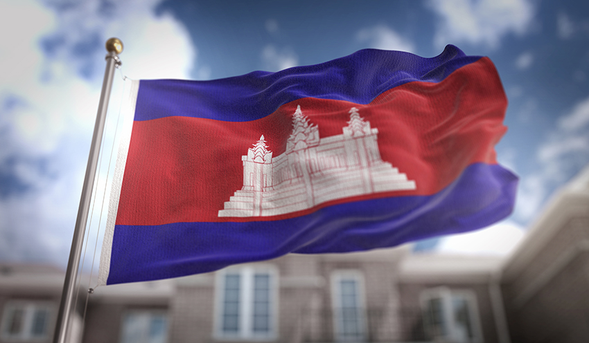 Cambodia Flag 3D Rendering on Blue Sky Building Background
