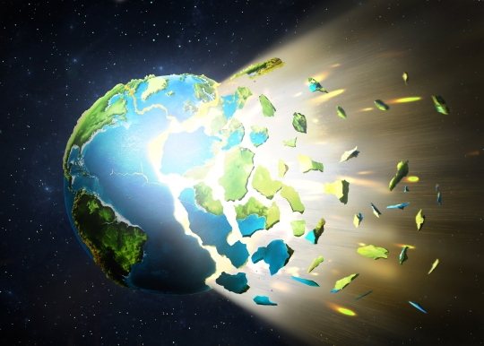 The planet explodes, scattering into pieces on a space background